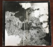 Photo from Wally's records; appears to be an aerial photo taken from a B-24, which was typically captured with a camera mounted to the Norden Bombsight that captured images of the bomb pattern after the Bombardier toggled, releasing the bombs on the MPI.