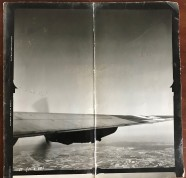 Photo from Wally's records; Appears to be from the 40s/50s; No Date; Image of Clouds and Wing Tip of a B-24.