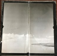 Photo from Wally's records; Appears to be from the 40s/50s; No Date; Image of Clouds and Wing Tip of a B-24. In the clouds, you can see another squadron of B-24s in formation.