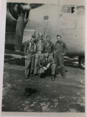 The five crewmembers who stayed at Shipdham and continued flying missions after completing their first tour: Whalen, Kennedy, Truslow, Sims, and Burns.