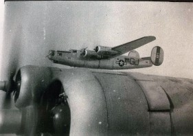 "Photo of Bar G aircraft, which was a B-24 flown by the 506th Squadron, but was not flown by Wally's crew. (The bar above the letter ""G"" on the tail indicates it was flown by the 506th Squadron.)"