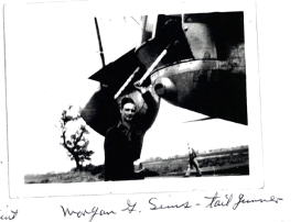 Morgan Sims, the Tail Gunner on Wally's Crew, standing near the tail of the crew's B-24 the day they left Shipdham for the United States.