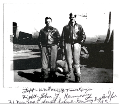 Wally and Kennedy standing in the field just off the hardstand before leaving Shipdham for the United States.