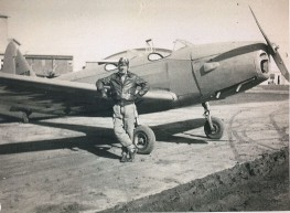 Unknown in front of PT-19. Likely Burns. Unknown who photo came from.