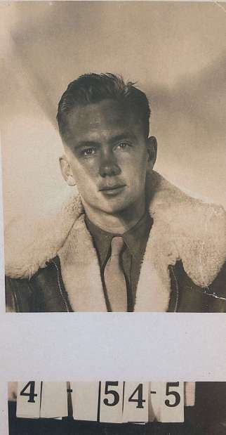Wally in the sheepskin garb worn by B-24 crews on all missions because temperatures in the non-heated and non-pressuriezed plane reached -50 degrees Farenheit. It is unknown when this photo was taken or what the numbers represent.