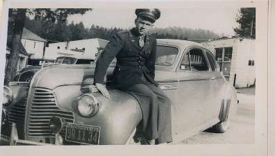 Wally sitting on a car with California license plates. Given that he doesn't have his Aerial Gunner Wings or his ribbons pinned on his formal Air Force uniform, this was likely taken before the war.